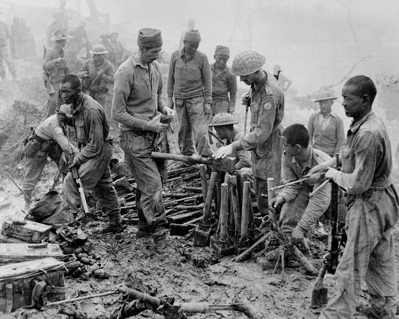 Men of 23rd Indian Division inspect captured Japanese ordnance at Imphal, 1944