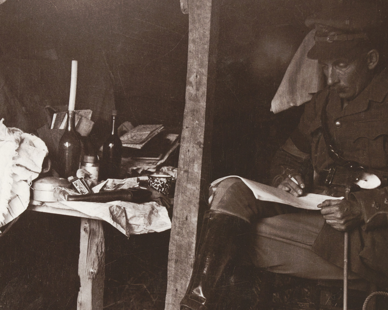 An officer relaxes in a dugout in the Ypres sector, c1917
