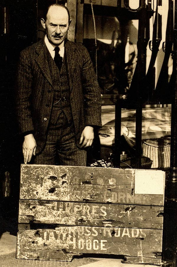 William Storie with the Hellfire Corner sign, c1920s