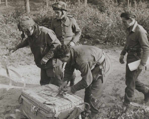 British airborne soldiers unwrap a parapack dropped on a resupply flight, 18 September 1944