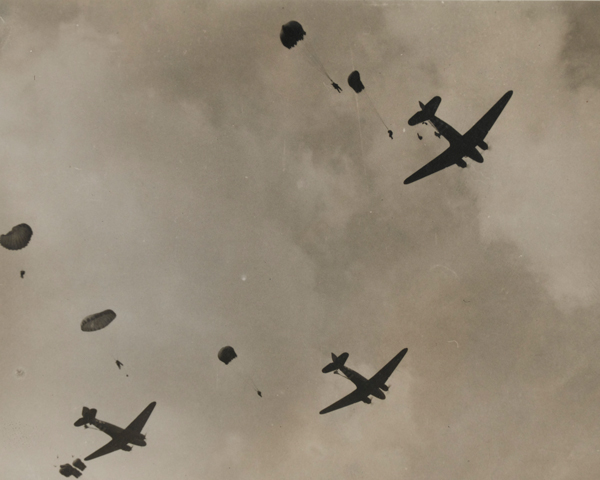 C-47 transport aircraft dropping parachutists and supply canisters on the outskirts of Arnhem, 17 September 1944