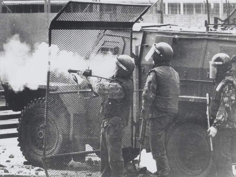 A soldier fires off a baton round, Northern Ireland, 1972