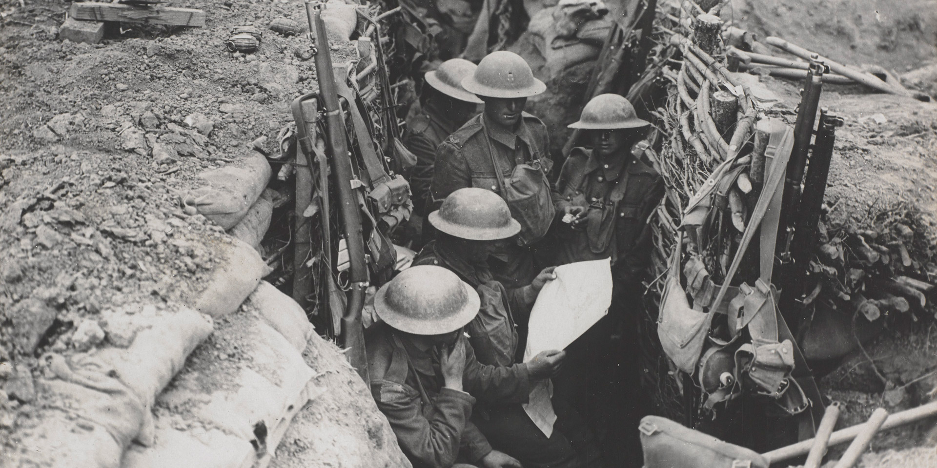 Reading a newspaper in the trenches, c1916