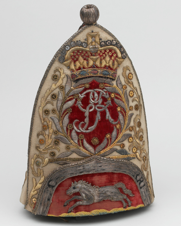 This grenadier cap of the 65th Regiment bears the royal cypher and the white horse of Hanover, c1758