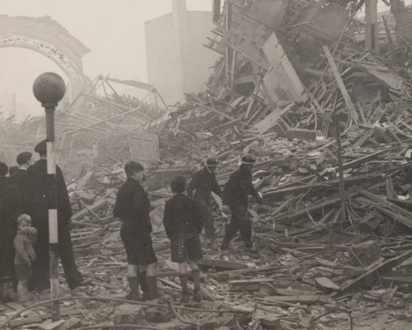 Schoolboys survey bomb damage, London, 18 October 1940