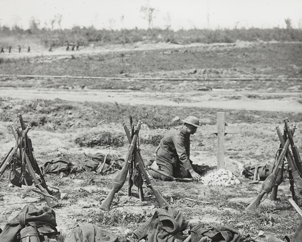 Tending a grave near Mametz Wood, 1916