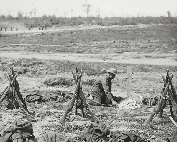 Tending a grave near Mametz Wood, 1916