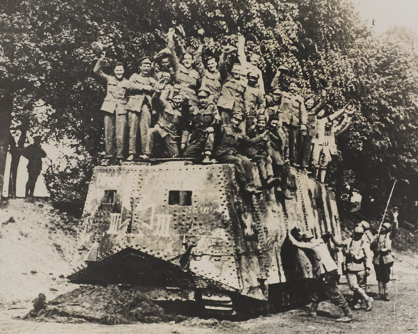 Allied soldiers on the roof of a captured A7V tank, 1918
