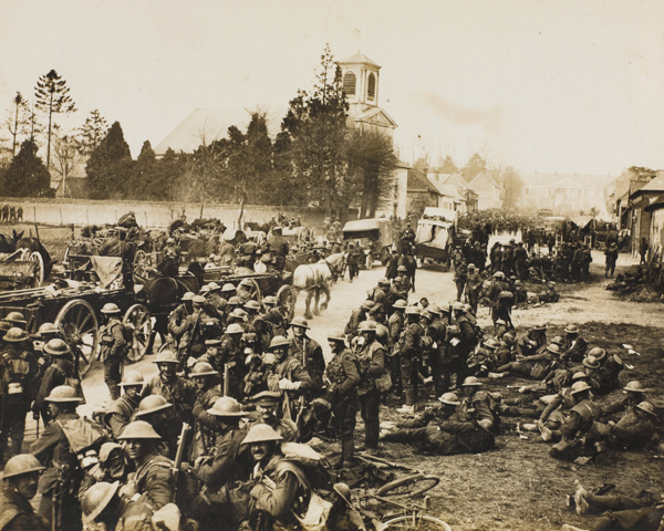 Soldiers of 17th (Northern) Division gather at Henencourt after the evacuation of Hermies, 26 March 1918