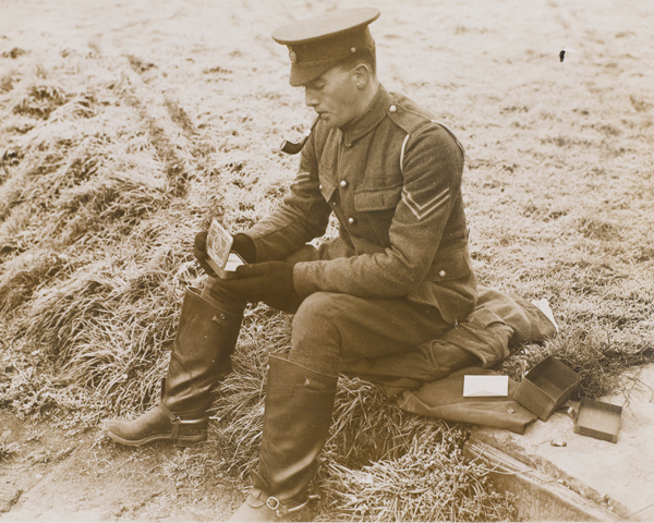 A soldier opening his Princess Mary Gift Tin, Christmas 1914
