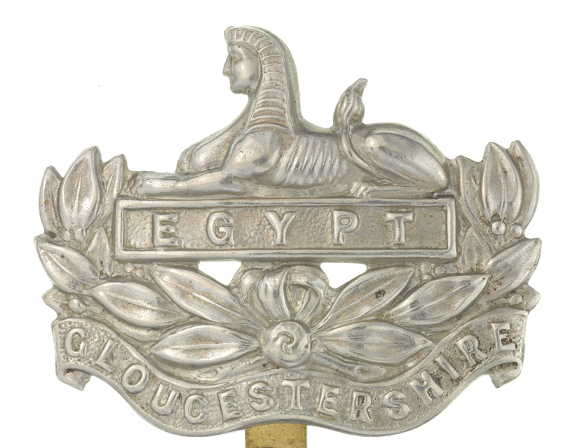 Cap badge of The Gloucestershire Regiment depicting a Sphinx