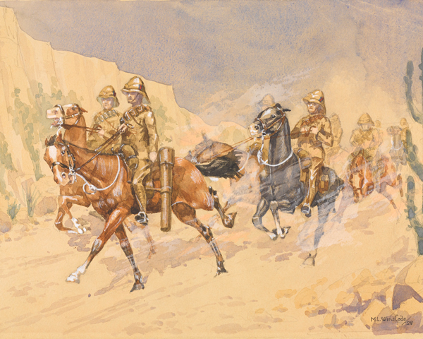 A troop of cavalry cantering along a track, North West Frontier of India, c1918