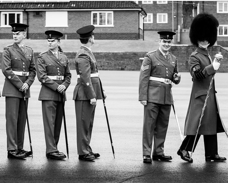 Warrant officers from the Welsh Guards wait to be presented their leeks on St David's Day, 2017