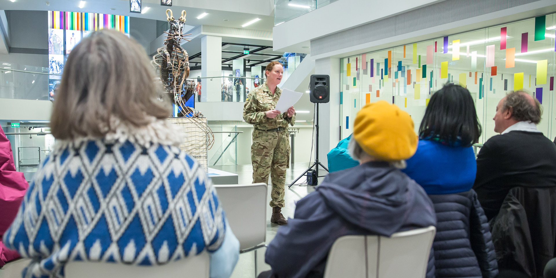 Woman soldier giving talk