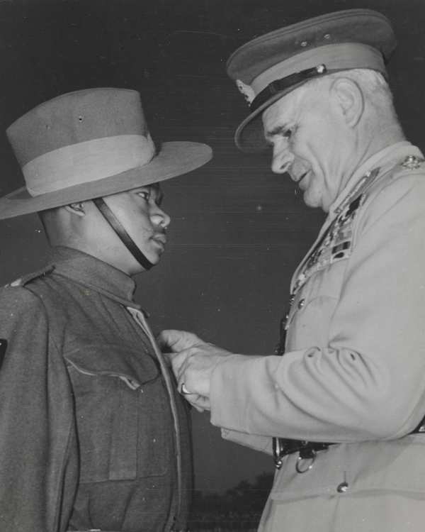 Field Marshal Sir Archibald Wavell, the Vicreoy of India, presents the Victoria Cross to a Gurkha soldier, December 1945