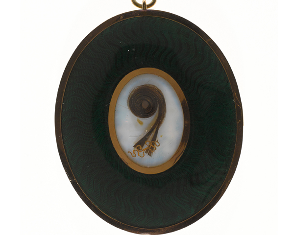 A lock of hair set into the back of a miniature by George Engleheart, c1800