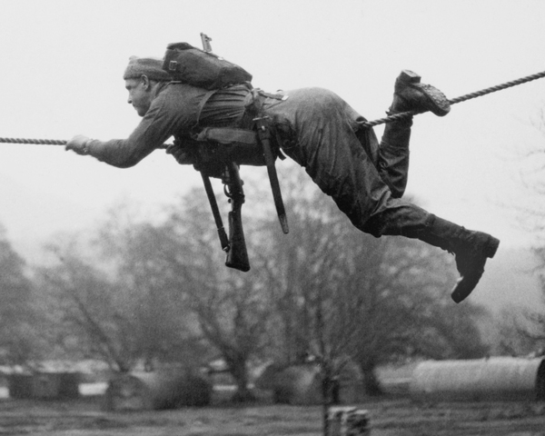 Crossing a river on a single rope at Achnacarry, c1942