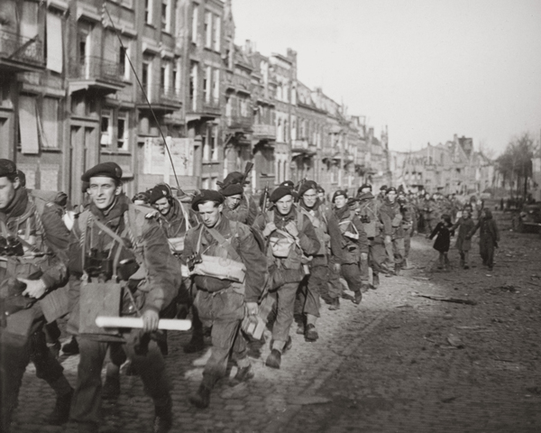Commandos march through Flushing during the capture of Walcheren, 1944