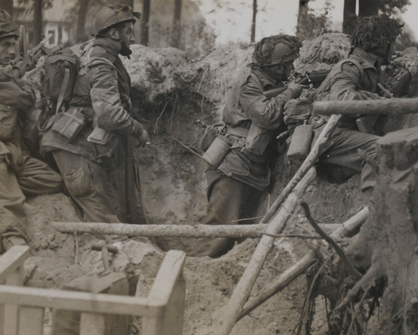 Paratroops of 1st Airborne Division take cover in a shell hole, Arnhem, 1944