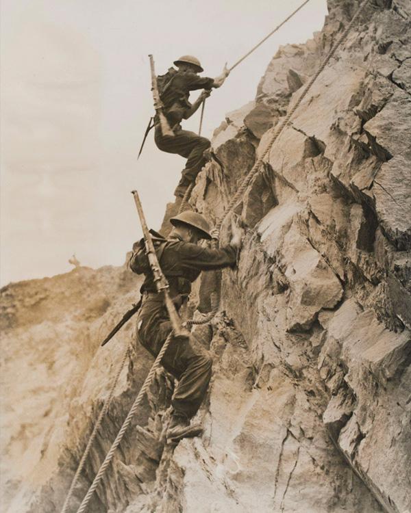 Climbing under livefire at the Commando Battle School, 1944