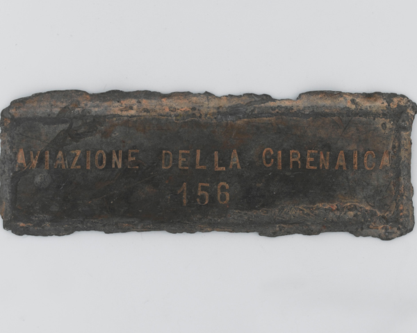 Plaque from the wreck of an Italian Savoia Marchetti SM79 aircraft destroyed by the LRDG at Jebel Uweinat, c1940