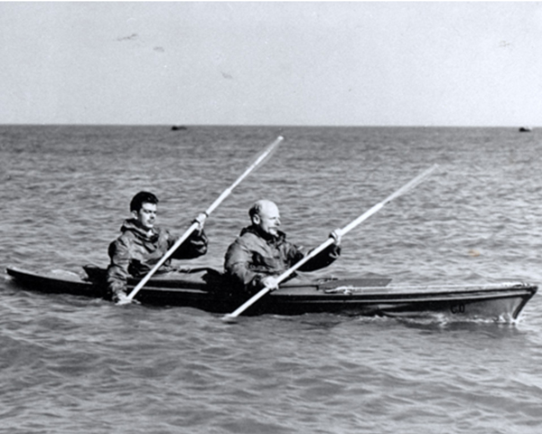 Major Herbert Hasler and a colleague paddling a canoe, c1942