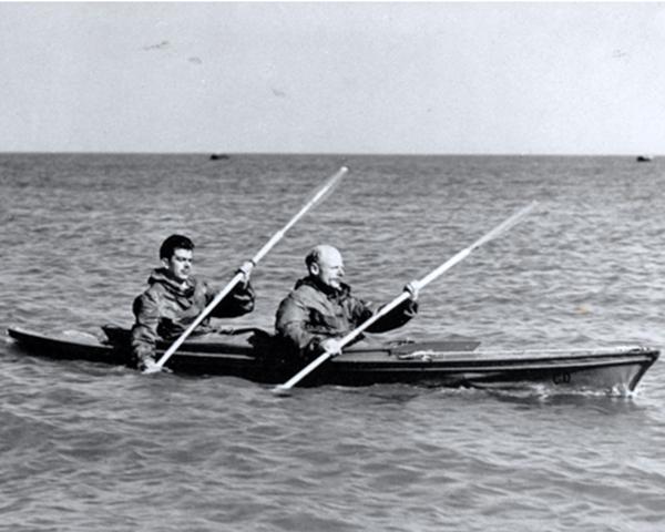 Major Herbert Hasler and a colleague paddling a canoe, c1942