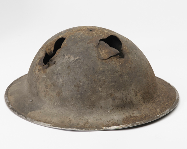 Battle damaged Mk II helmet worn by Sergeant John Knowler during the Dieppe Raid, 1942