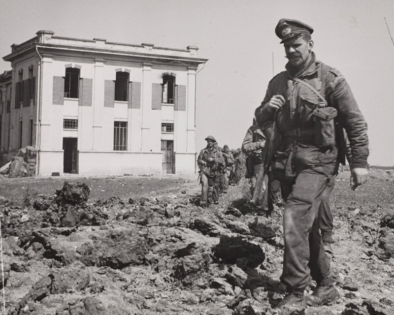 Men of 40 Royal Marine Commando leave a power plant they destroyed at Lake Comacchio, Italy, 11 April 1945