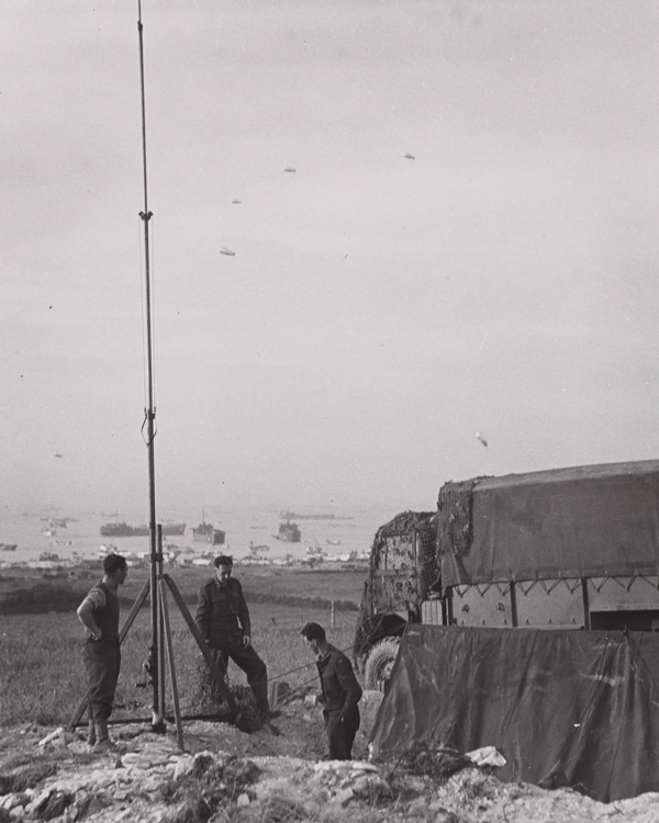 A signals unit erecting a radio mast on one of the Normandy beaches, June 1944