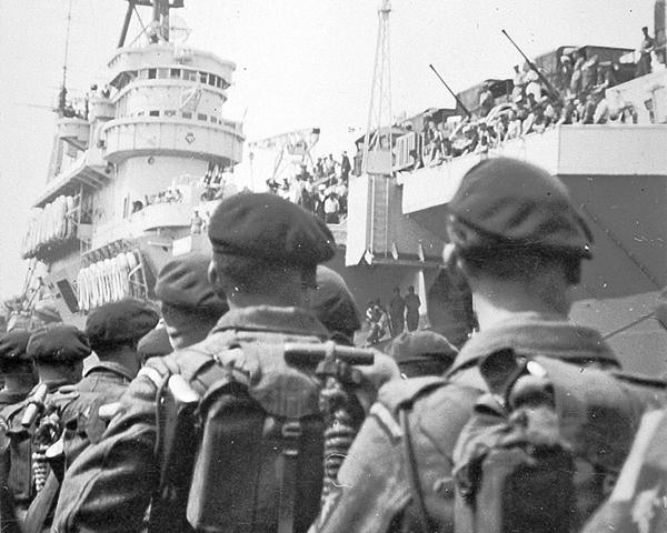 3rd Battalion, The Parachute Regiment, boarding HMS 'Triumph' at Portsmouth bound for Cyprus, June 1951