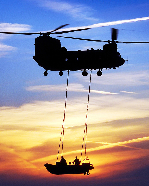A Chinook lowering an SBS boat