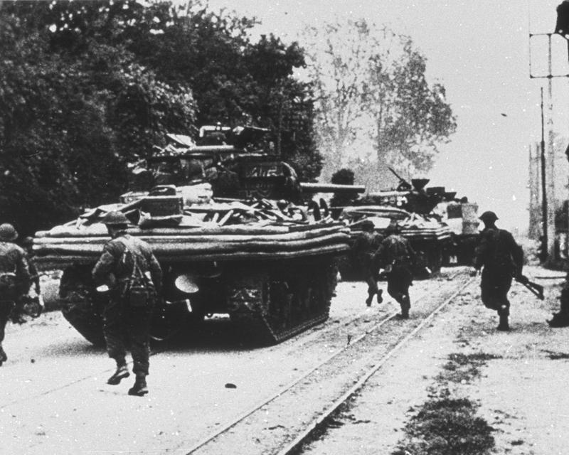 Amphibious Sherman tanks moving through Ouistreham, 6 June 1944