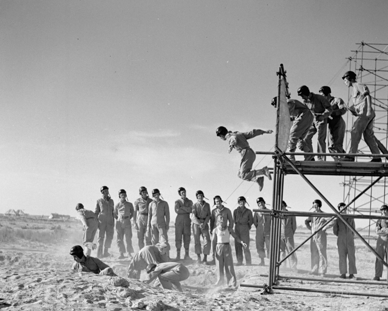 SAS volunteers jumping from steel gantries while undergoing parachute training, c1942