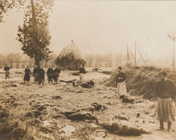 French Zouaves bury German dead at Chemin, 1914