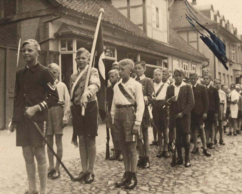 German youth marching under the Nazi banner, c1935