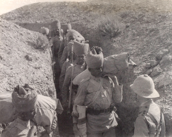 Indian troops passing through a communication trench, 1917