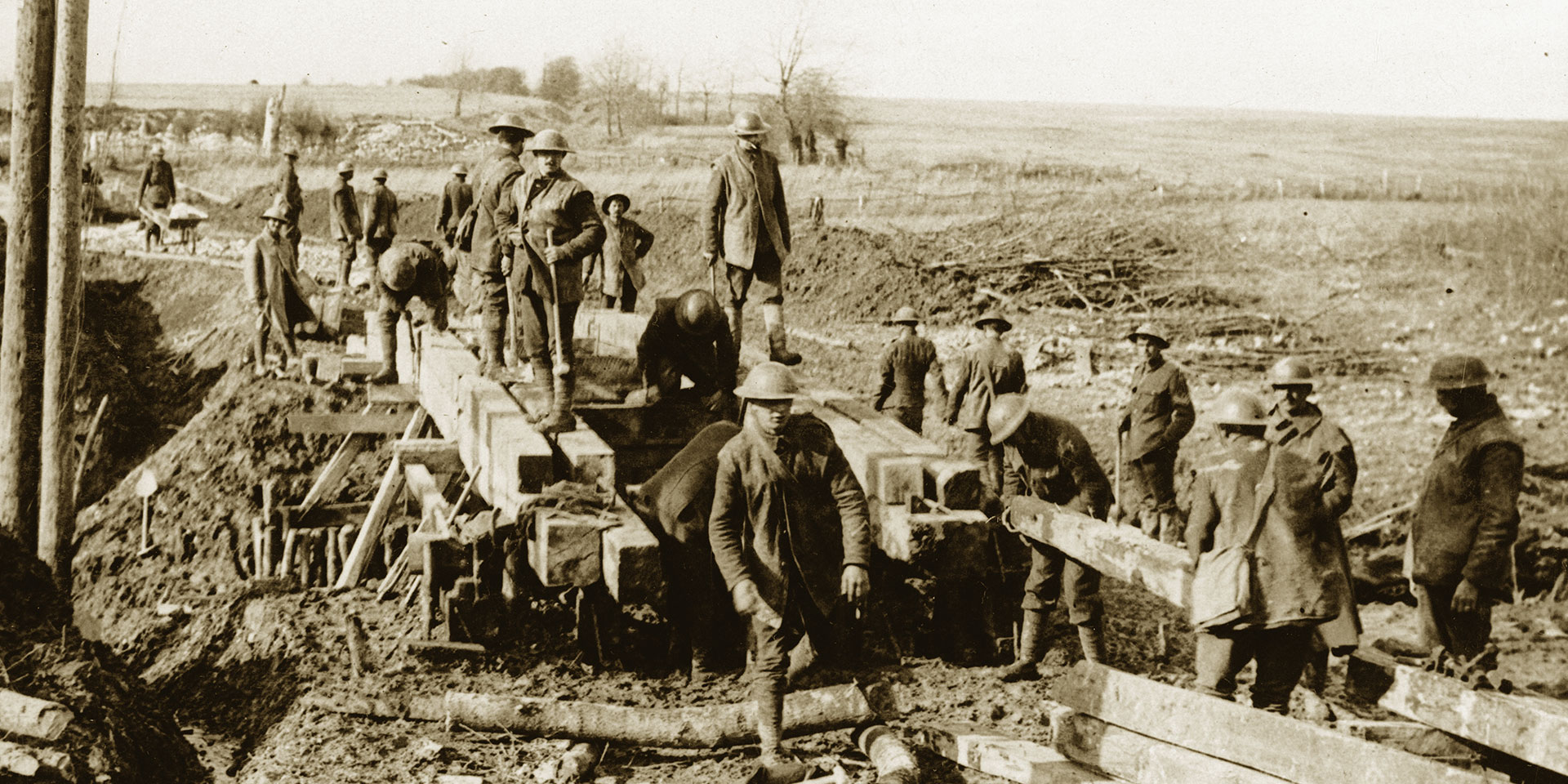 Soldiers bridging a stream in the First World War