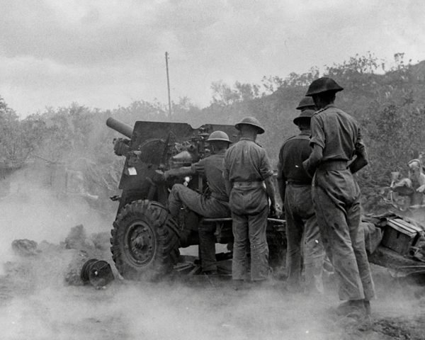 25-pounders in action on the Adrano-Bronte road, Sicily, August 1943