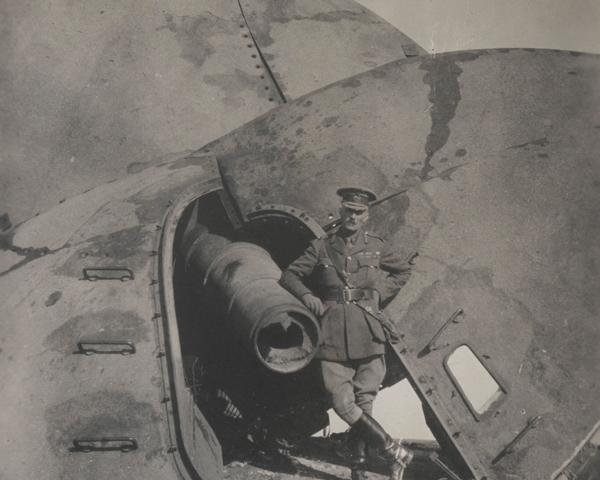 Major-General Barnardiston next to a wrecked gun at Fort C, Tsingtao, November 1914