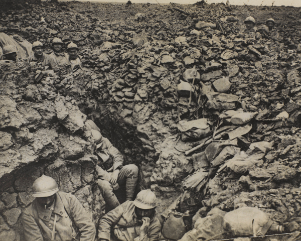 French soldiers of the 87th Regiment shelter in their trenches at Côte 304 at Verdun, 1916
