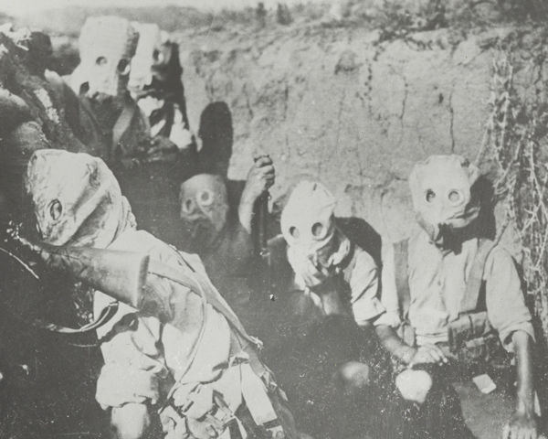 British troops wearing gas masks in the trenches, Salonika, 1917