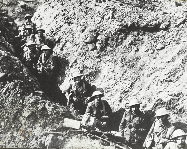 Soldiers from 2nd Battalion The Auckland Regiment wait in a trench near Flers, 1916
