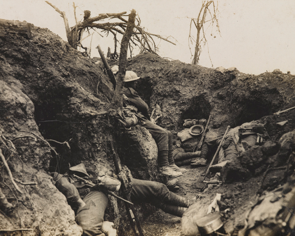 Soldiers of the Border Regiment resting in a front line trench, Thiepval Wood, August 1916