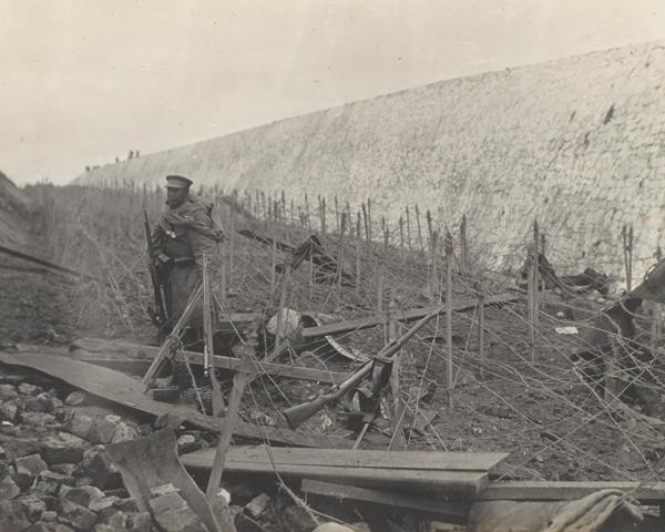 Japanese sentry among barbed wire entanglements, Tsingtao, November 1914
