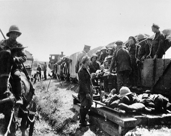 Wounded being sent to hospital on a light railway, 1916