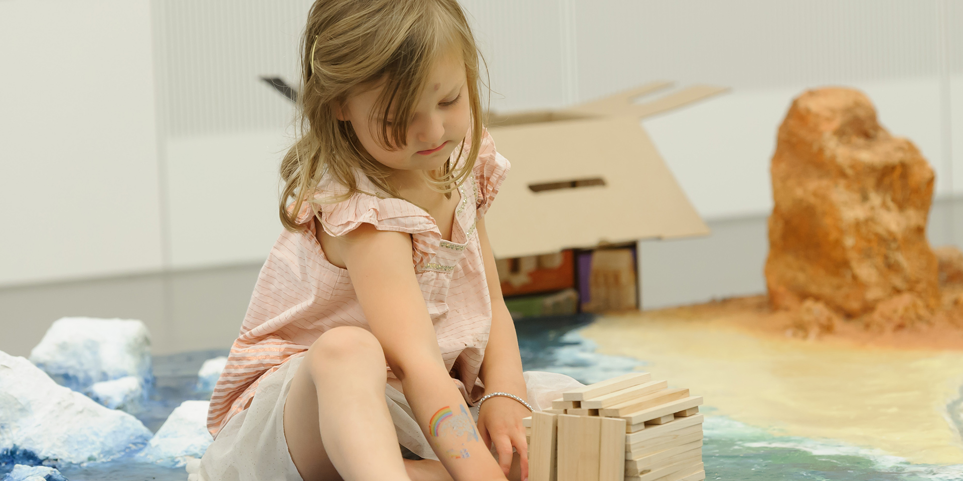 Child playing with construction blocks