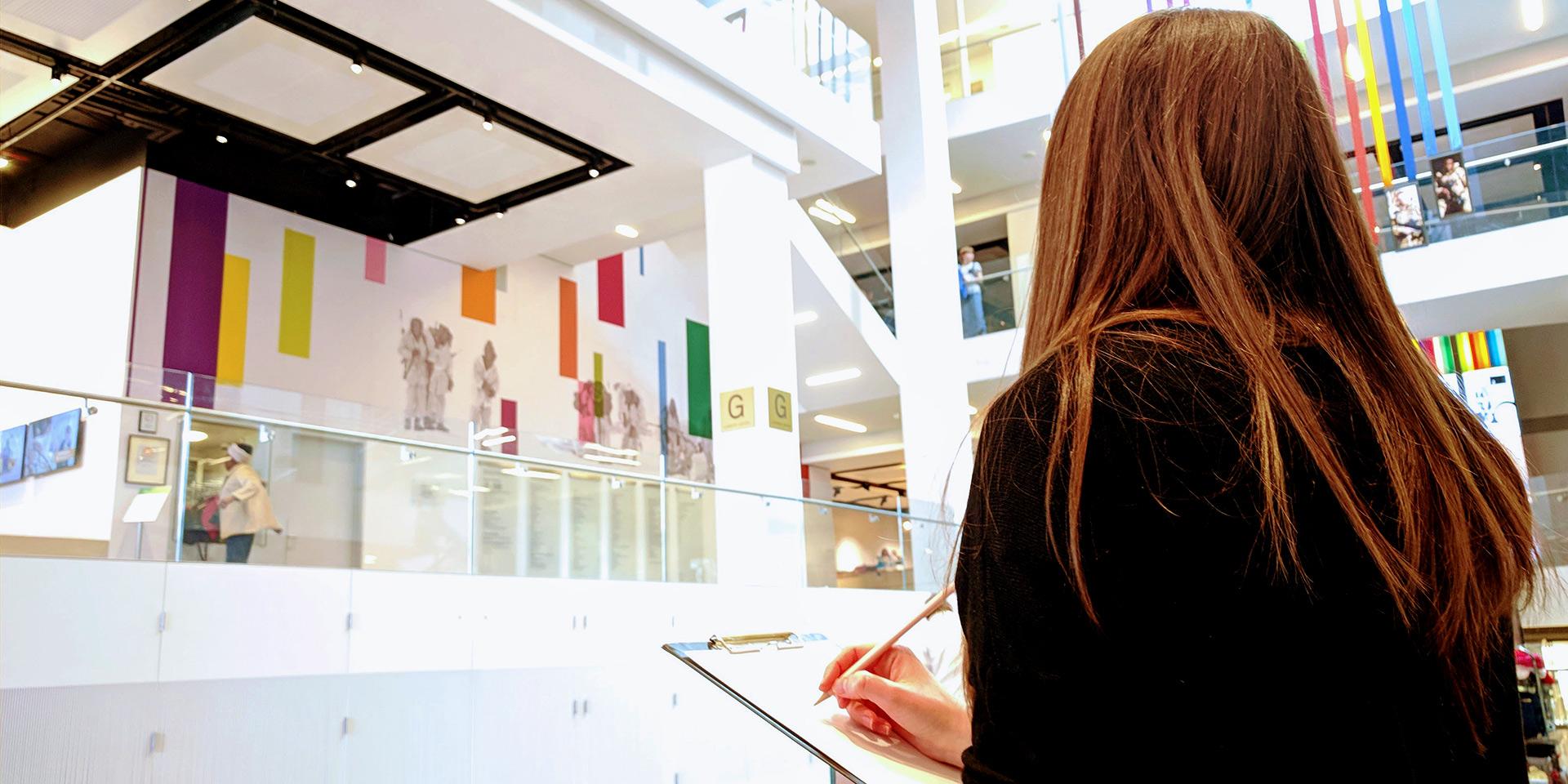 Visitor sketching museum