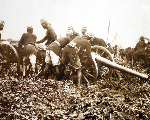 African soldiers moving a field gun into position, 1914