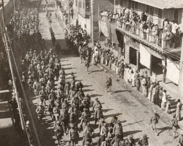 Turkish prisoners being marched down Main Street, Baghdad, March 1917